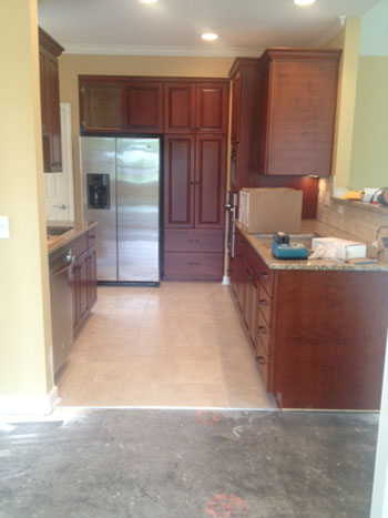 Construction progress of kitchen in a Villa cabinets, appliances and counter in place