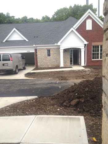 View of new Villa from outside with dirt in yard waiting for landscaping