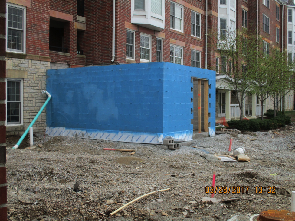 bistro under construction outside view with blue sheets covering framing