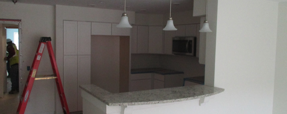 Construction at Riverstone shows ladder in kitchen area