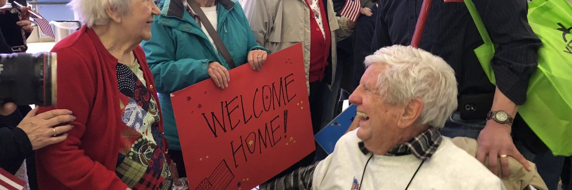 Honoring residents who served our country with signs and flags