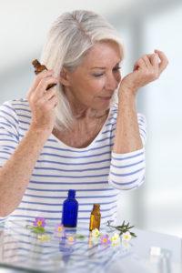 woman samples aromatherapy oils