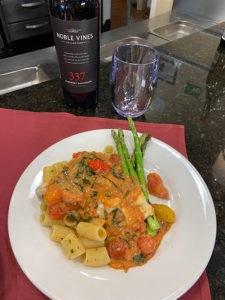 plate of pasta with asparagus and wine