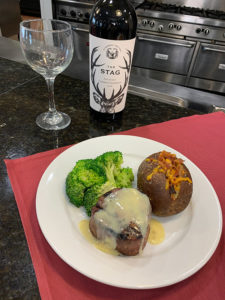 nutritious meal of steak, broccoli and potato with wine