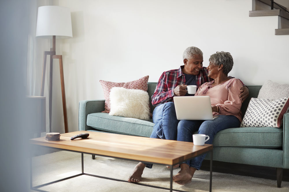 older african american couple exploring senior living options on a computer