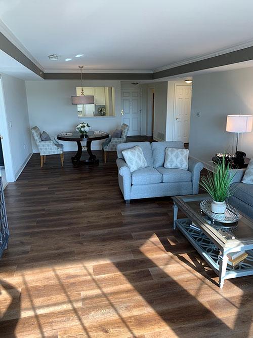 Bay window throws sunlight across spacious living room in Carrigan 2 floor plan