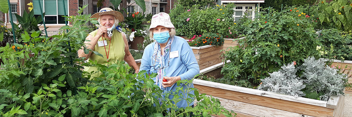 Working in the resident gardens promotes environmental wellness for two women