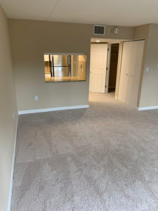 Living and dining area in The Brandon independent living apartment